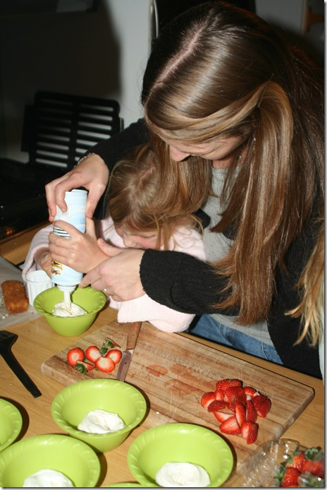finishing touches to the dessert Katie and mom made - meringues, cream and fruit baskets