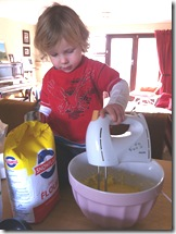 Micah helps make cupcakes this morning