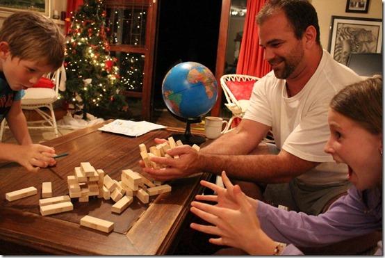 family playing Jenga together